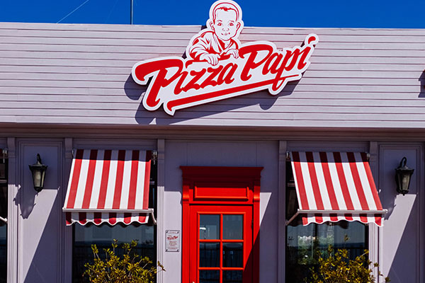 Restaurant storefront signs for Pizza Papi